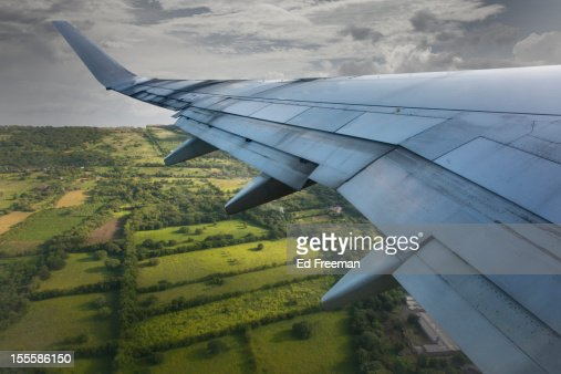 View of Airplane Wing and Nicaragua Below : Stock Photo