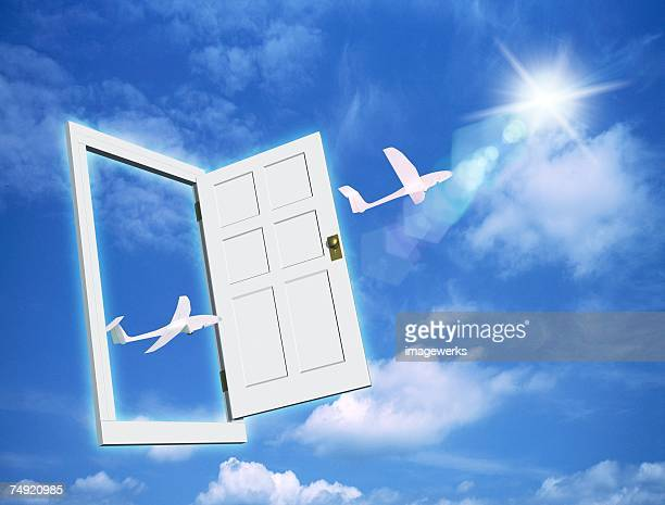 View of airplanes moving through open door (digital composite)