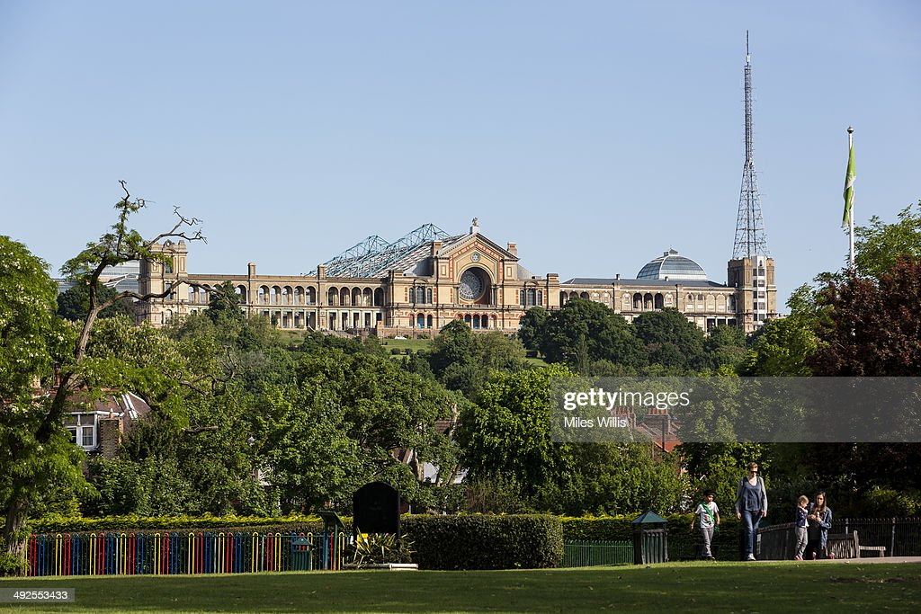 A view of Alexandra Palace from Priory Park on May 21, 2014 in London, England. Alexandra Palace situated in the London Borough of Haringey First opened as 'The PeopleÕs Palace' in 1873. Just 16 days later a fire broke out in the Palace, burning it down in its entirety. On 2 November the world's first regular high-definition public television broadcast took place from the BBC studios at Alexandra Palace. In 1980 fire again burned a large part of the building, the Palace reopened in 1988. Recently awarded a Round 1 pass from The Heritage Lottery Fund the Palace plans to renovate parts of the derelict building including the BBC Studios and Victorian Theatre.