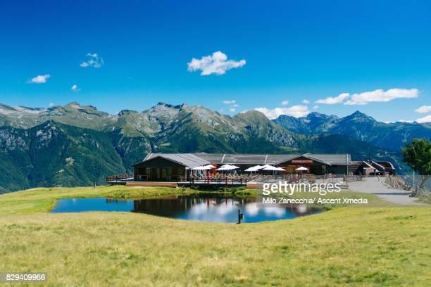 View of alpine hut and lake