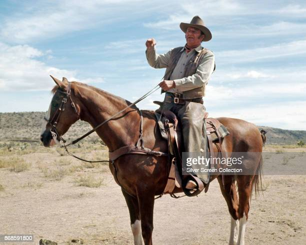 View of American actor John Wayne on horseback in a scene from the film 'Chisholm' 1970