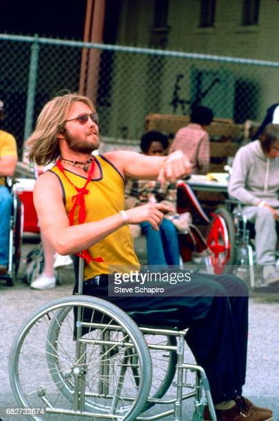 View of American actor Jon Voight in a wheelchair with a football in his lap in a scene from the film 'Coming Home' California 1978