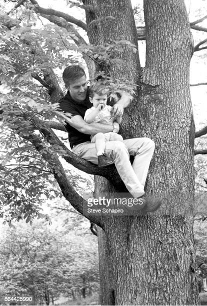 View of American actor Robert Redford and his son David as they sit on a tree branch in Central Park New York New York 1966