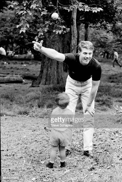 View of American actor Robert Redford as he plays with his son David in Central Park New York New York 1966