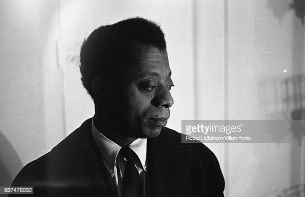 View of American author and playwright James Baldwin as he sits backstage at the ANTA Playhouse New York New York April 1964 He was there to attend...