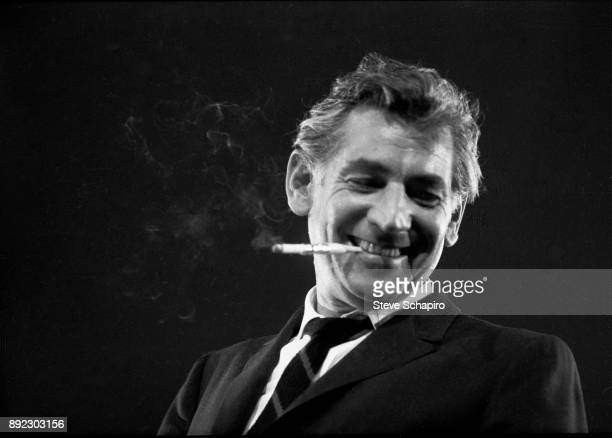 View of American composer musician and conductor Leonard Bernstein a cigarette in his mouth as he conducts at Carnegie Hall New York New York 1959