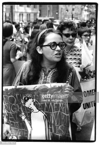 View of American feminist activist author and artist Kate Millett as she attends an equal rights demonstration on Fifth Avenue New York New York...