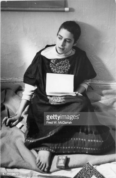 View of American film director and performance artist Barbara Rubin as she sits barefoot in Allen Ginsberg's apartment New York New York November 1...