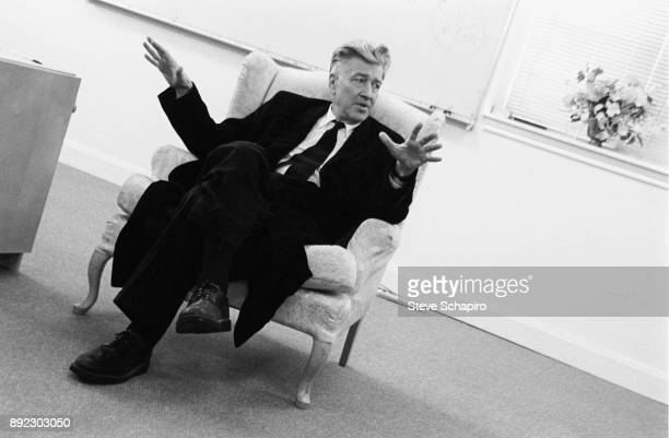 View of American film director David Lynch seated in an armchair as he gestures while he speaks Iowa 2005
