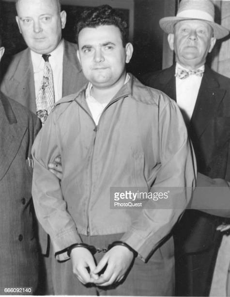 View of American machinist David Greenglass as US marshals escort him to a hearing in Federal Court New York New York June 1950 He was accused of and...