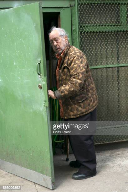 View of American photographer and filmmaker Robert Frank as he opens a door New York New York March 2017