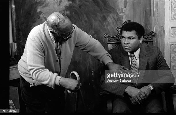 View of American photographer James Van Der Zee and heavyweight boxer Muhammad Ali during a photo shoot New York April 13 1981