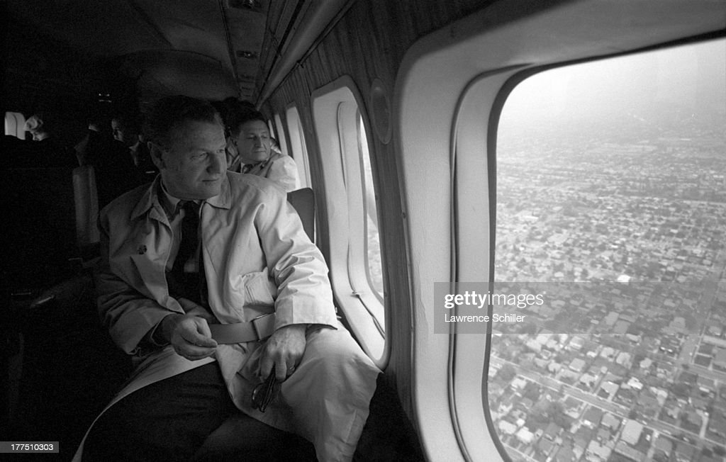 View of American politician Nelson Rockefeller (1908 - 1979) on a plane as he campaigns for the Republican presidential nomination, California, 1964.