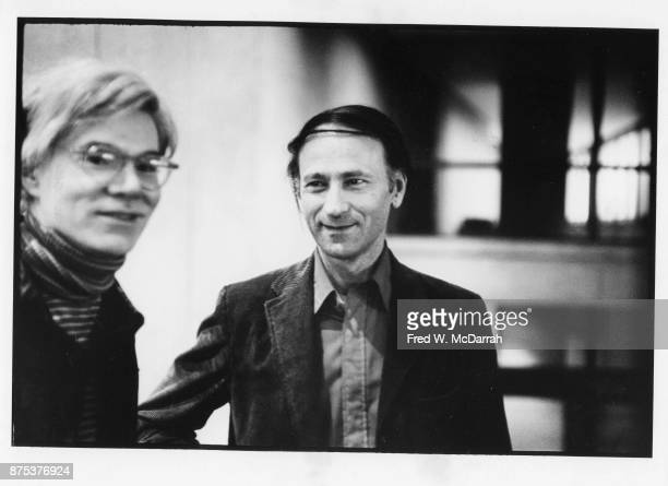 View of American Pop artist Andy Warhol and Lithuanian American avantgarde film director Jonas Mekas at Filmmakers Cinematheque New York New York...