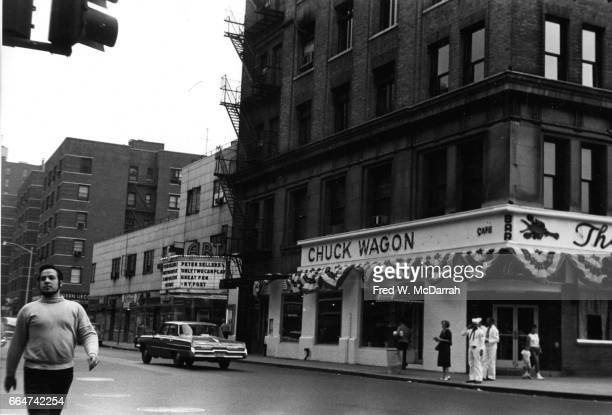 View of American theatre producer and cafeowner Joseph Cino as he walks west on East 8th Street in Greenwich Village New York New York July 8 1962...