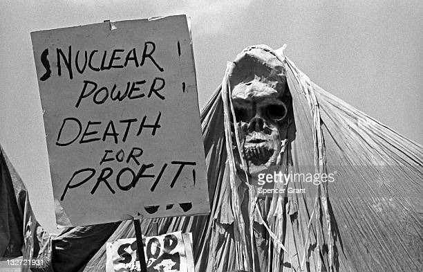 View of an antinuclear power demonstration with protestors carrying signs held at Kendall Square in Cambridge Massachussetts 1974