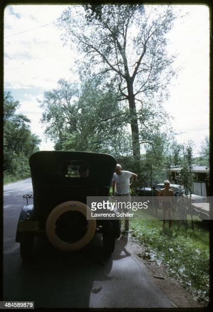 View of an antique car on the side of a residential street Wallace South Dakota 1968