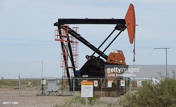 View of an Argentinian oil company YPF's pumpjack to extract oil from a well at Loma La Lata near Vaca Muerta Shale oil reservoir in the Patagonian...