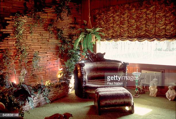 View of an armchair in the corner of the 'Jungle Room' in Elvis Presley's home Graceland Memphis Tennessee September 17 1994 Presely sat in the chair...