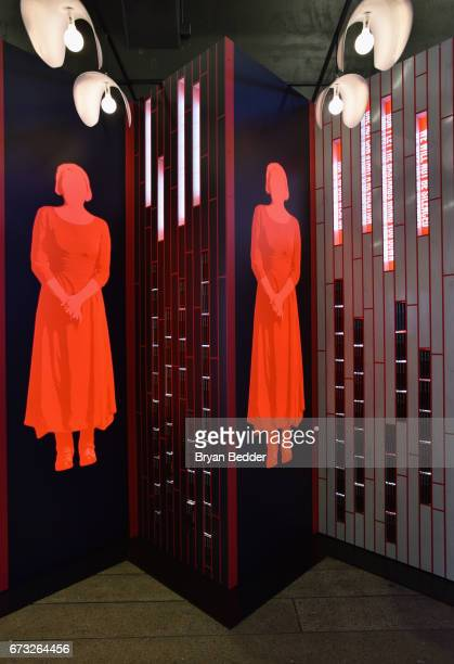 A view of an art installation designed by Paula Scher and Abbott Miller and book giveaway celebrating Hulu's 'The Handmaid's Tale' opens on the High...