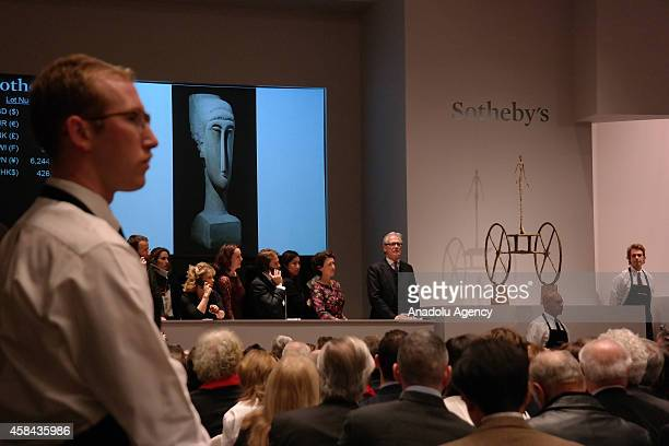 A view of an auction in which Alberto Giacometti's Chariot was sold for $101 million and Amadeo Modigliani's Tête sold for $707 million at Sotheby's...