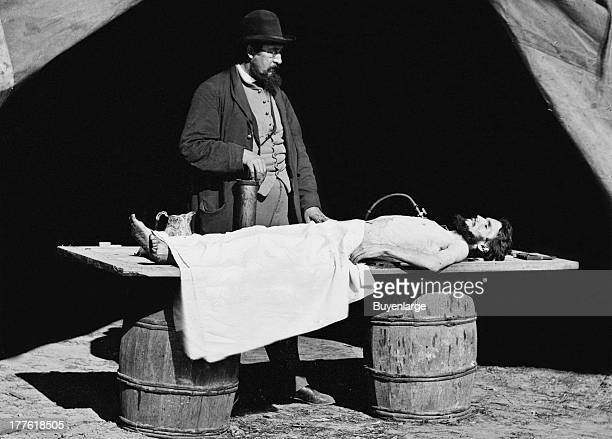 View of an embalming surgeon at work on soldier's body 1863 During the early part of the Civil War it was the embalming surgeons many of whom were...