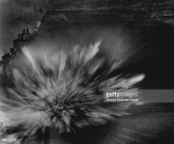 View of an explosion on the flight deck of the American aircraft carrier USS Enterprise after a Japanese bomb scored a direct hit August 1942