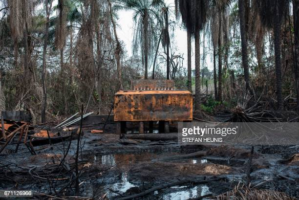 A view of an illegal oil refinery destroyed by members of the NNS Pathfinder of the Nigerian Navy forces is pictured on April 19 2017 in the Niger...