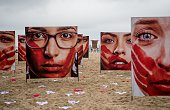 View of an installation set up by NGO Rio de Paz to porotest against violence against women displaying some 420 panties and portraits of bloodstained...