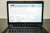 A view of an IRS 1040 Tax Form on a Laptop computer screen being prepared for an electronic filing