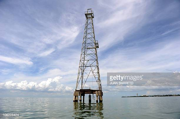View of an oil tower in Maracaibo Lake located in the border state of Zulia in western Caracas on October 27 2010 AFP PHOTO/Juan BARRETO