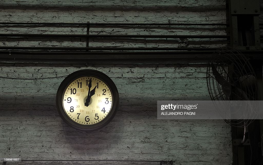 View of an old clock at the garage El Polvorin, in the neighborhood of Caballito, where the historic wagons La Brugoise are repaired, in Buenos Aires on January 4, 2013. The Line A will be closed betwen January 12 and March 8 following a decision by Buenos Aires city Mayor Mauricio Macri to replace the fleet with Chinese-made wagons. Line A was the first subway line to work in the southern hemisphere and its trains are among the ten oldest still working daily. The La Brugeoise wagons were constructed between 1912 and 1919 by La Brugeoise et Nicaise et Delcuve in Belgium. AFP PHOTO / ALEJANDRO PAGNI