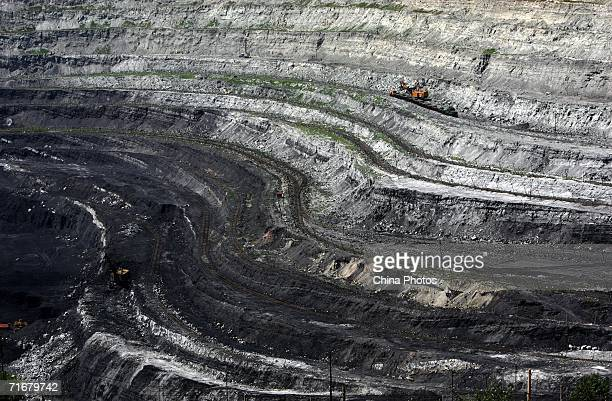 A view of an open pit coal mine is seen on August 19 2006 in Chifeng of Inner Mongolia Autonomous Region China Pingzhuang Coal Groups Company...