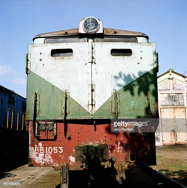 View of an operating locomotive in the Phnom Penh rail yards For years the trains were a target of Khmer Rouge attacks The rail yards and barns in...