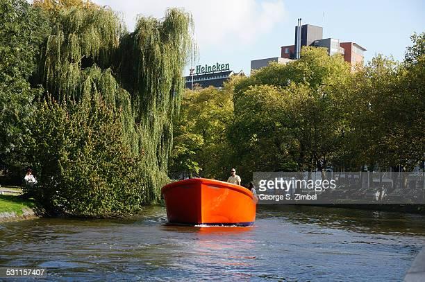 View of an orange boat on a canal near a Heineken factory Amsterdam Netherlands September 14 2014