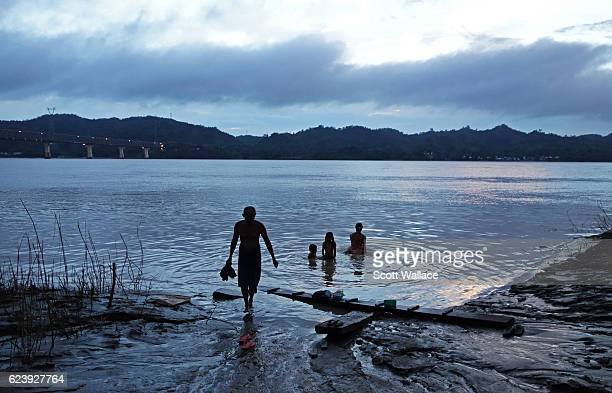 View of an unidentified family as they bath in the Irrawaddy River outside Pyay Myanmar 2013