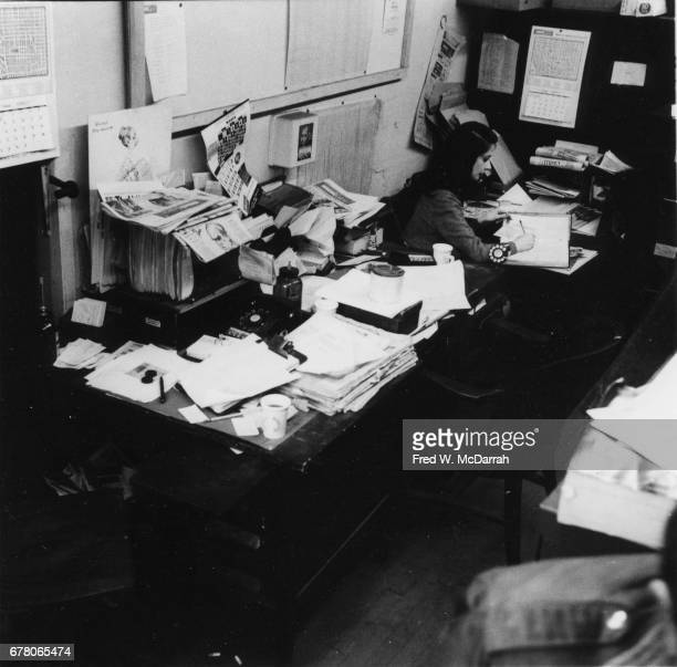 View of an unidentified woman as she works at a desk in the offices of the Village Voice New York New York February 25 1960