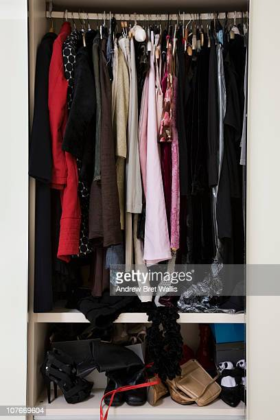 view of an untidy female wardrobe