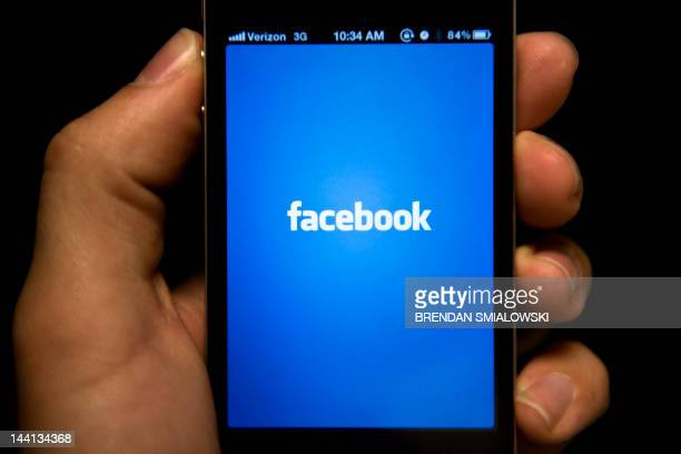 A view of and Apple iPhone displaying the Facebook app's splash screen May 10 2012 in Washington DC Socialnetworking giant Facebook will go public on...