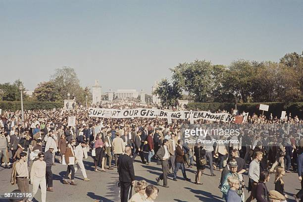 View of anti Vietnam War demonstrators marching and protesting as they make their way past the Lincoln Memorial during a march to the Pentagon in...