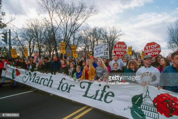 View of antiabortion demonstrators many with signs behind a large banner during the annual March for Life Washington DC January 23 1995 Among the...