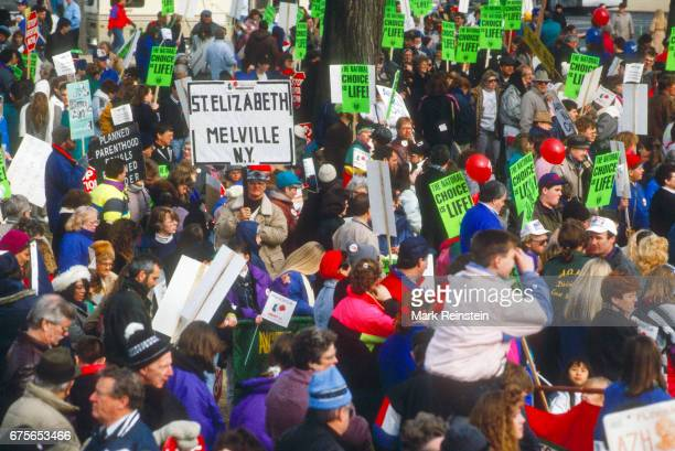 View of antiabortion demonstrators many with signs during the annual March for Life Washington DC January 22 1992 Among the visible signs are ones...