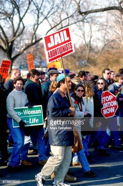 View of antiabortion demonstrators many with signs during the annual March for Life Washington DC January 22 1996 Among the visible signs are ones...