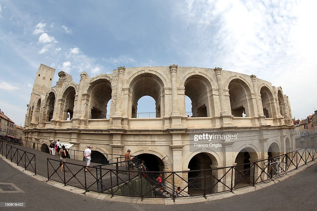 A view of Arles Amphitheatre (a Roman arena) on August 11, 2012 in Arles, France. Arles is a city in the south of France in the Mouths of the Rhone. The city has a long history, and was of considerable importance in the Roman province of Gallia. The Roman Monuments of the city were listed as UNESCO World Heritage in 1981. The Dutch painter Vincent van Gogh lived in Arles in 1888-1889 and produced over 300 paintings and drawings during his time there.