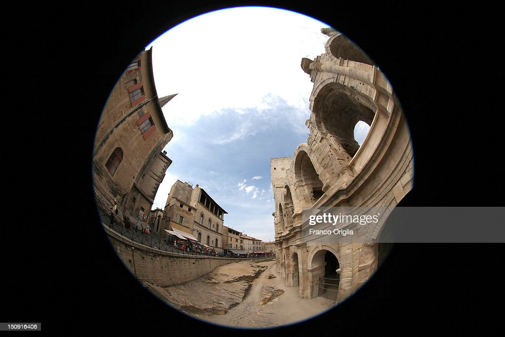 A view of Arles Amphitheatre (R) on August 11, 2012 in Arles, France. Arles is a city in the south of France in the Mouths of the Rhone. The city has a long history, and was of considerable importance in the Roman province of Gallia. The Roman Monuments of the city were listed as UNESCO World Heritage in 1981. The Dutch painter Vincent van Gogh lived in Arles in 1888-1889 and produced over 300 paintings and drawings during his time there.