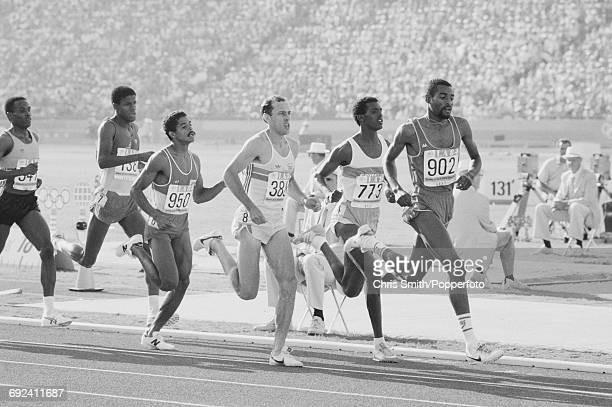 View of athletes competing in heat 3 of the quarterfinals of the Men's 800 metres event with from left Owen Hamilton of Jamaica Bruce Roberts of...