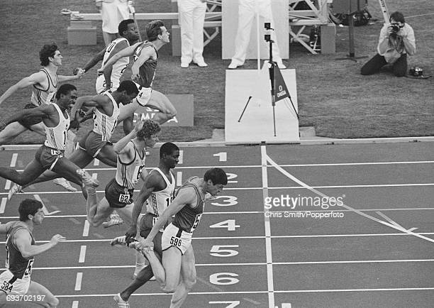 View of athletes competing in the final of the Men's 100 metres event with gold medallist Allan Wells of Scotland in foreground silver medallist Ben...