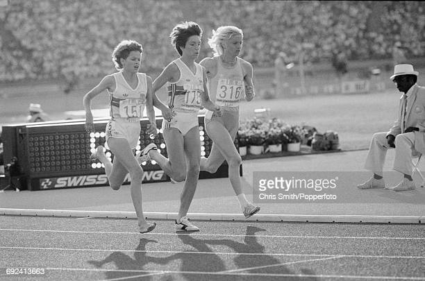 View of athletes competing in the final of the Women's 3000 metres event with from left Zola Budd of Great Britain running barefoot silver medal...