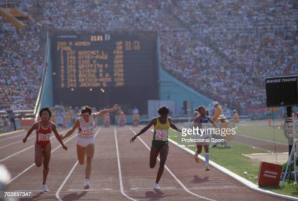 View of athletes from left to right silver medal winner Florence Griffith Joyner of the United States 4th placed Kathy SmallwoodCook of Great Britain...