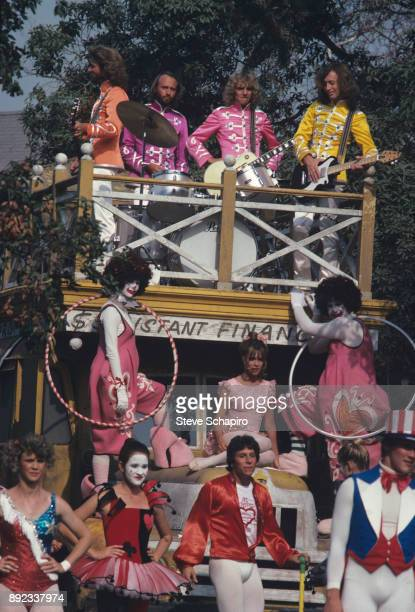 View of atop bus from left musicians Barry and Maurice Gibb Peter Frampton and Robin Gibb along with Sandy Farina in a scene from the film 'Sgt...